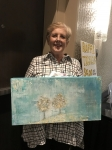 Winner MaryLynn Posner Rhodes with painting donated to raffle by Terry Fontaine